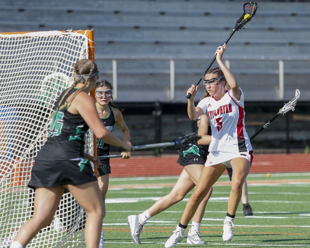 Stillwater's Annie McGuire fires a shot on goal against Hill-Murray Wednesday night. McGuire scored five goals for the Ponies in their 13-8 victory over the Pioneers. Photo by Jeff Lawler, SportsEngine