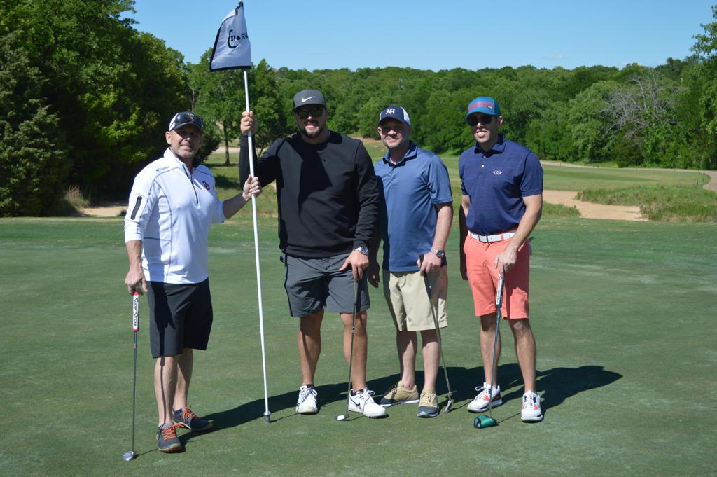 Click on image to view/download photos taken at the golf tournament.