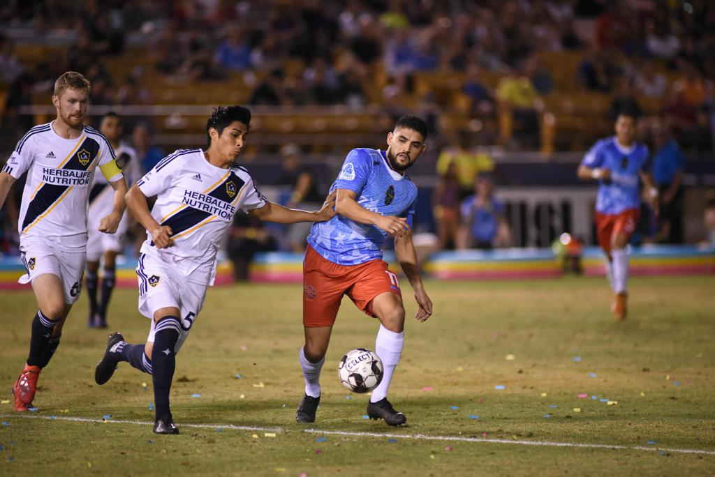 Irvin Parra (right) leads Las Vegas this season with 10 goals and four assists. (Photo by LV Lights)