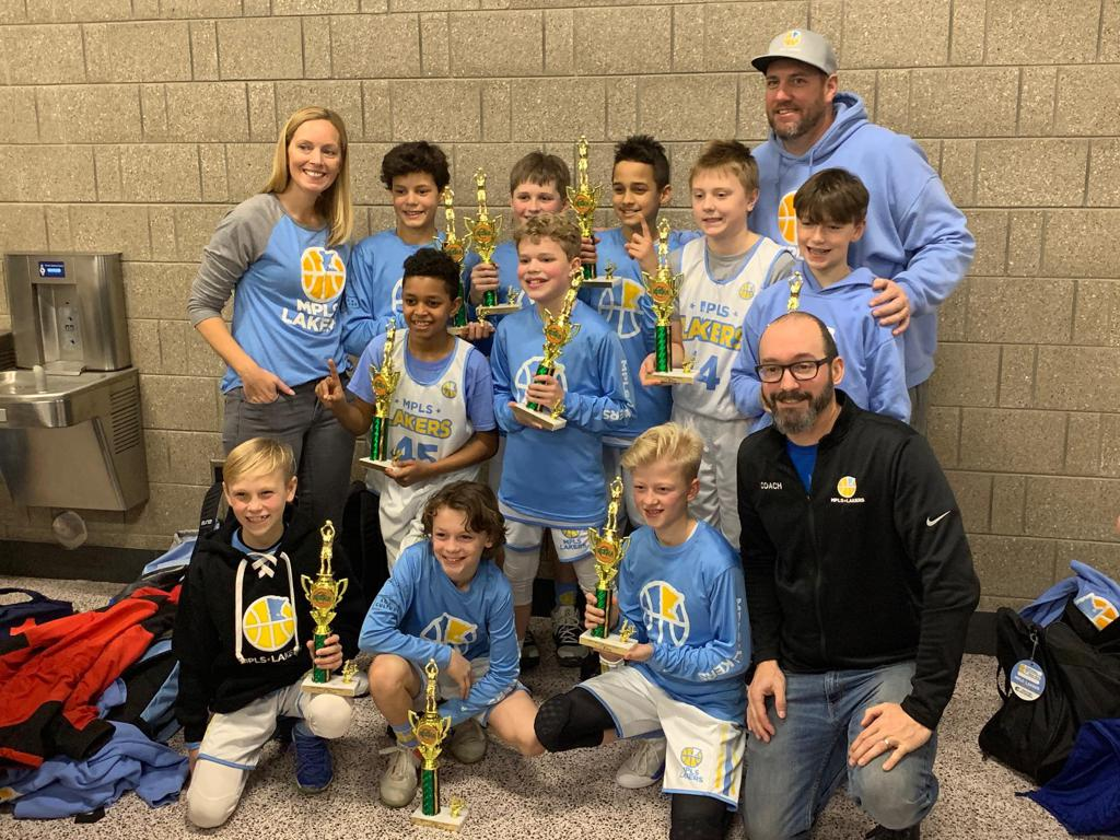 Mpls Lakers Youth Traveling Basketball Program Inc Boys 5th Grade Gold pose with their Trophies after becoming the Champions at the Edina Cake Eater Classic tournament in Edina, MN