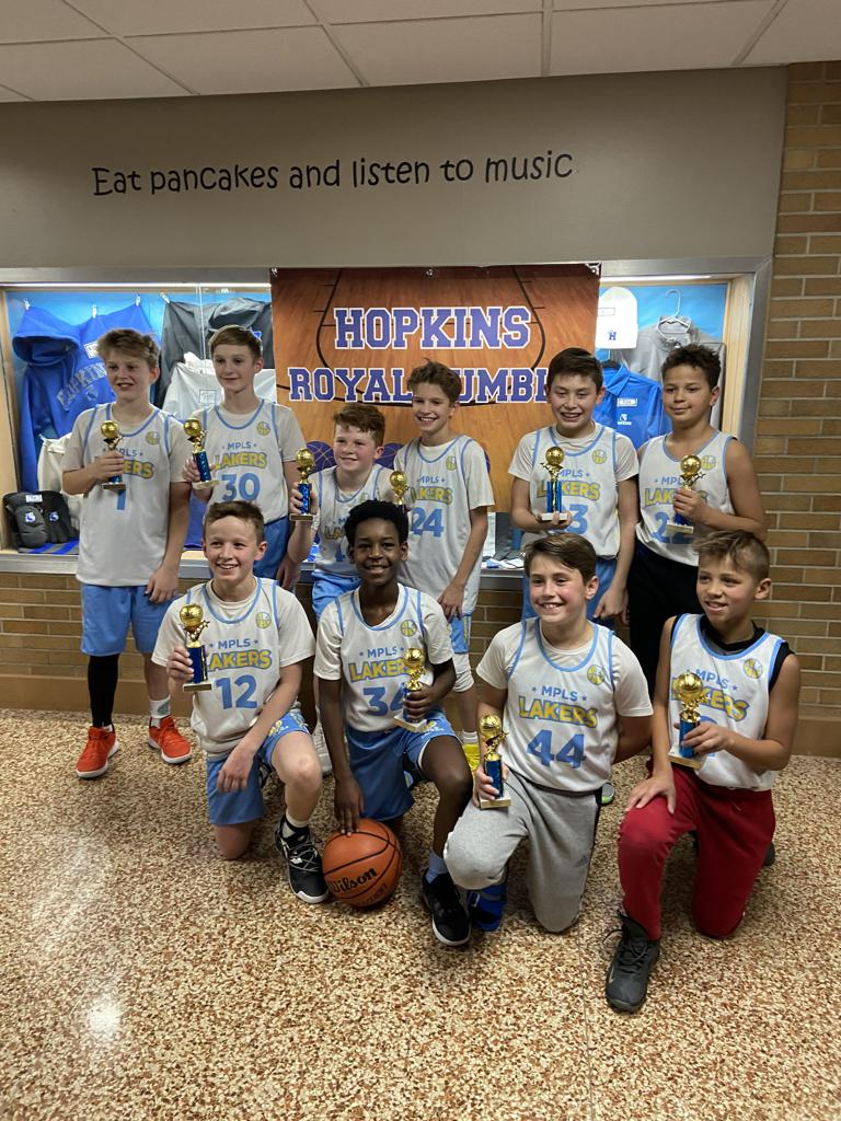 Minneapolis Lakers Youth Basketball Program  Boys 6th Grade Gold pose after earning 3rd place at the Hopkins Royal Rumble tournament in Hopkins, MN