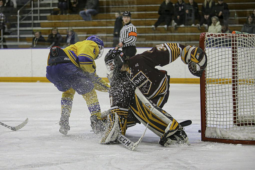 Hastings junior forward Kyle Bauer poked the puck past Northfield goalie Cal Frank to complete the scoring in a 10-1 victory. Photo by Mark Hvidsten, SportsEngine