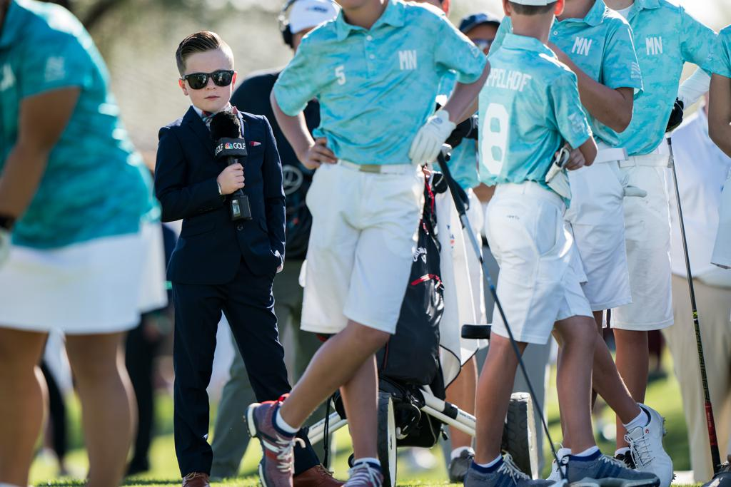 Junior reporter Warren Fisher, 11, at the PGA Jr. League Championship presented by National Car Rental