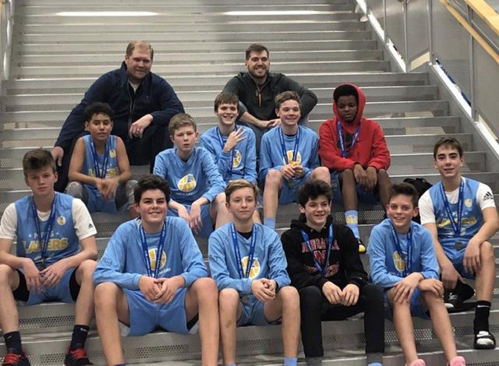 Minneapolis LakersBoys 8th Grade Gold pose with their medals after earning 3rd place at the Rogers Winter Warmup tournament in Rogers, MN
