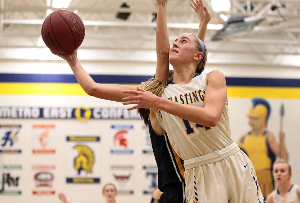 Hastings' Mallory Brake (14) drives the baseline for a layup. Brake led all scoring with 35 points at Mahtomedi High School on Friday night. Photo by Cheryl A. Myers, SportsEngine