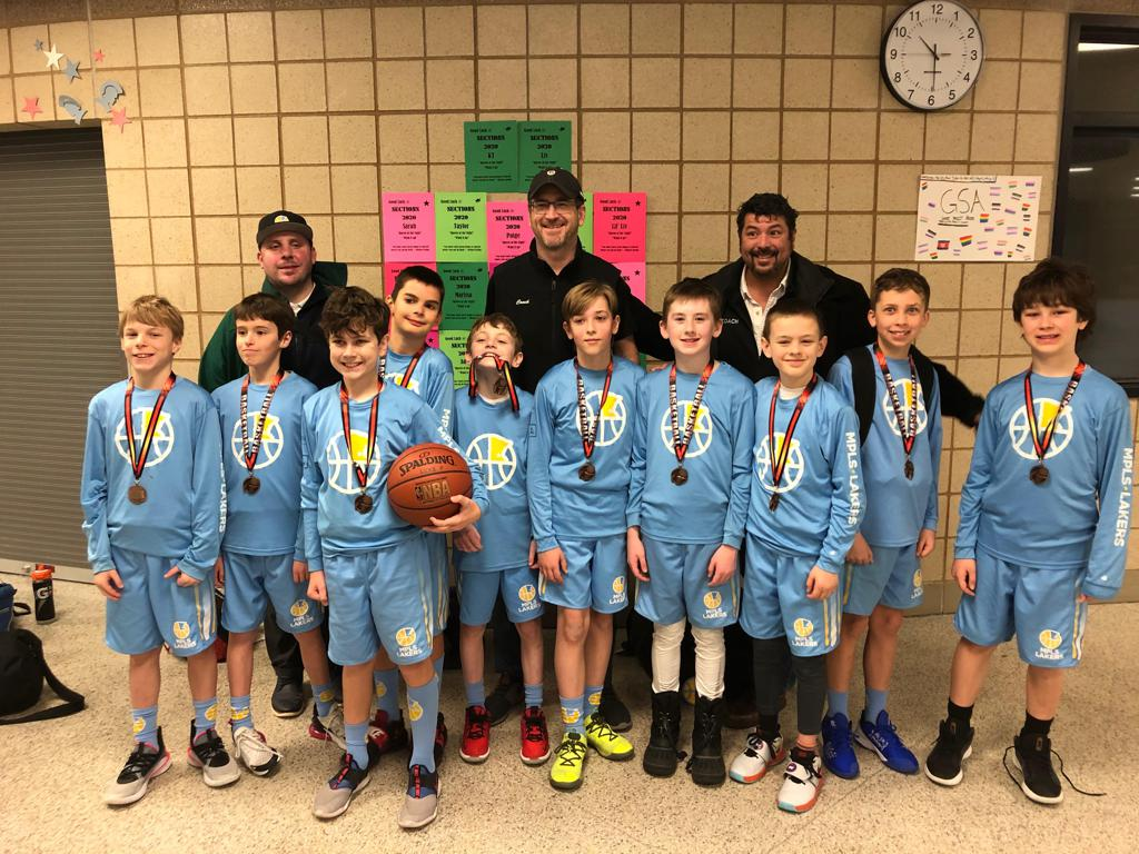 Mpls Lakers Youth Traveling Basketball Program Inc Boys 5th Grade White pose with medals after earning 3rd place at the Inver Grove Heights tournament in Inver Grove Heights, MN