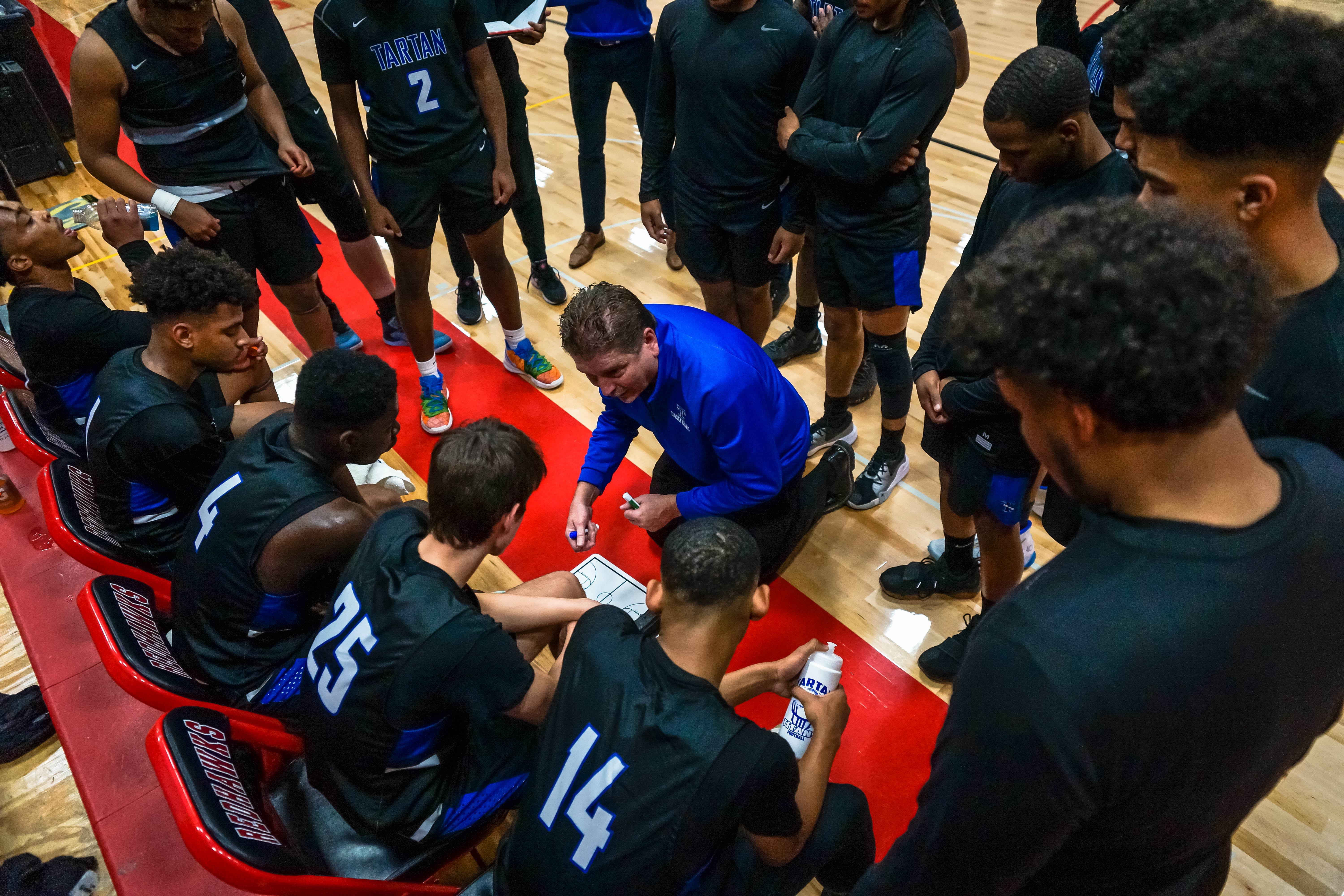 Tartan regroups during a timeout Dec. 14 while playing Robbinsdale Cooper at Minnehaha Academy. Photo by Korey McDermott, SportsEngine