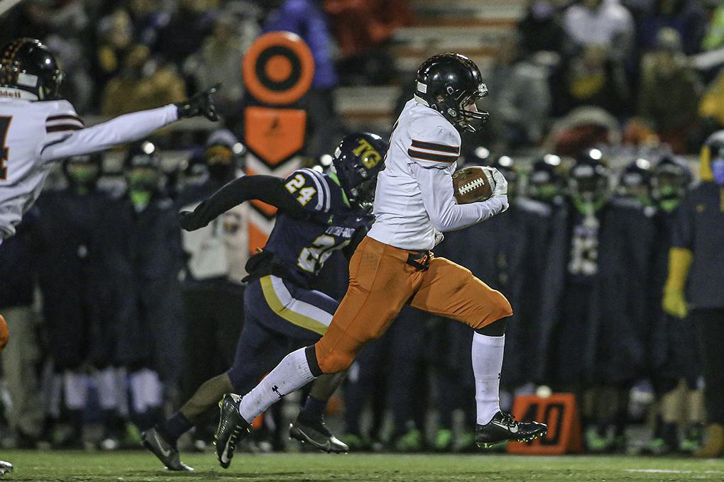 Osseo linebacker Owen Dukowitz returns a second-quarter interception for a touchdown. Photo by Mark Hvidsten, SportsEngine