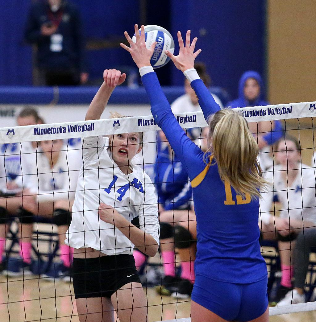 Sophomores Kali Engeman (14) and Sophia Jesewitz (13) square off at the net in the second set. Engeman's strong net play helped Minnetonka roll past Wayzata. Photo by Cheryl Myers, SportsEngine