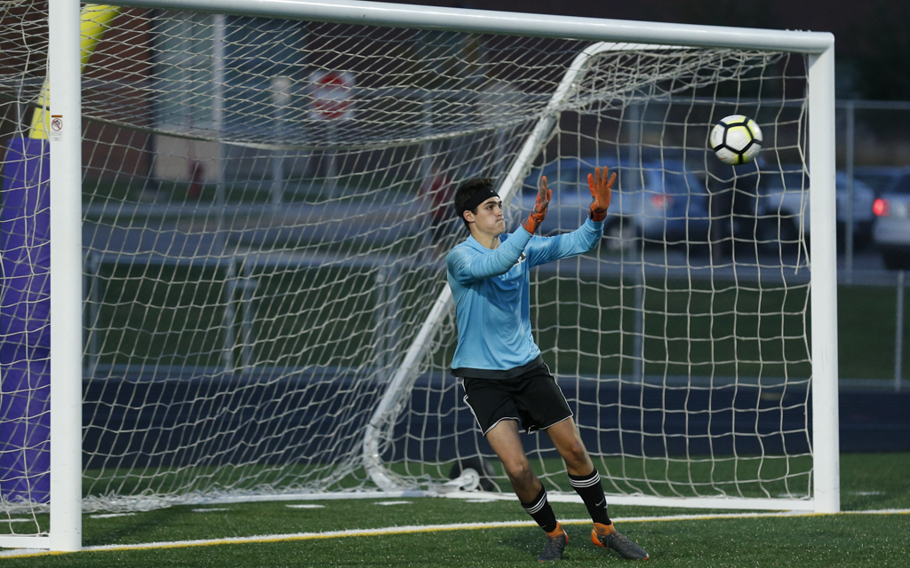 Orono goalkeeper Michael Hughes (21) moves across the goal to make a save on a Waconia set play in the first half Tuesday night. Hughes allowed no goals in the Spartans' 2-0 victory over the Wildcats. Photo by Jeff Lawler, SportsEngine