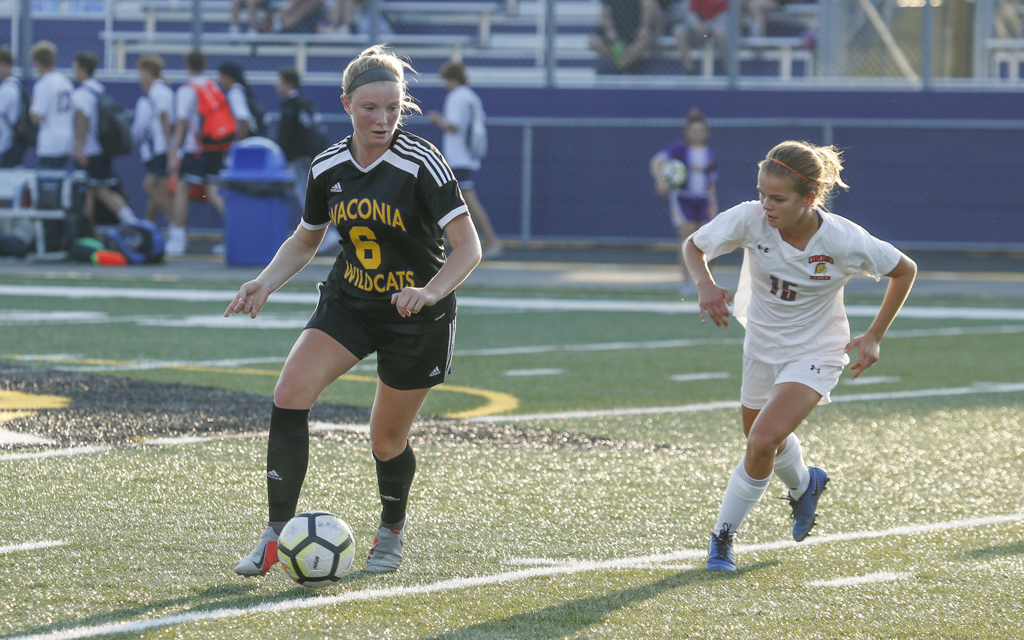 Waconia's Melissa Honnold dribbles around Orono's Nora Chouanard during the second half of Tuesday evening's match. Honnold scored the Wildcats' lone goal in their 1-1 draw with the Spartans in Waconia. Photo by Jeff Lawler, SportsEngine