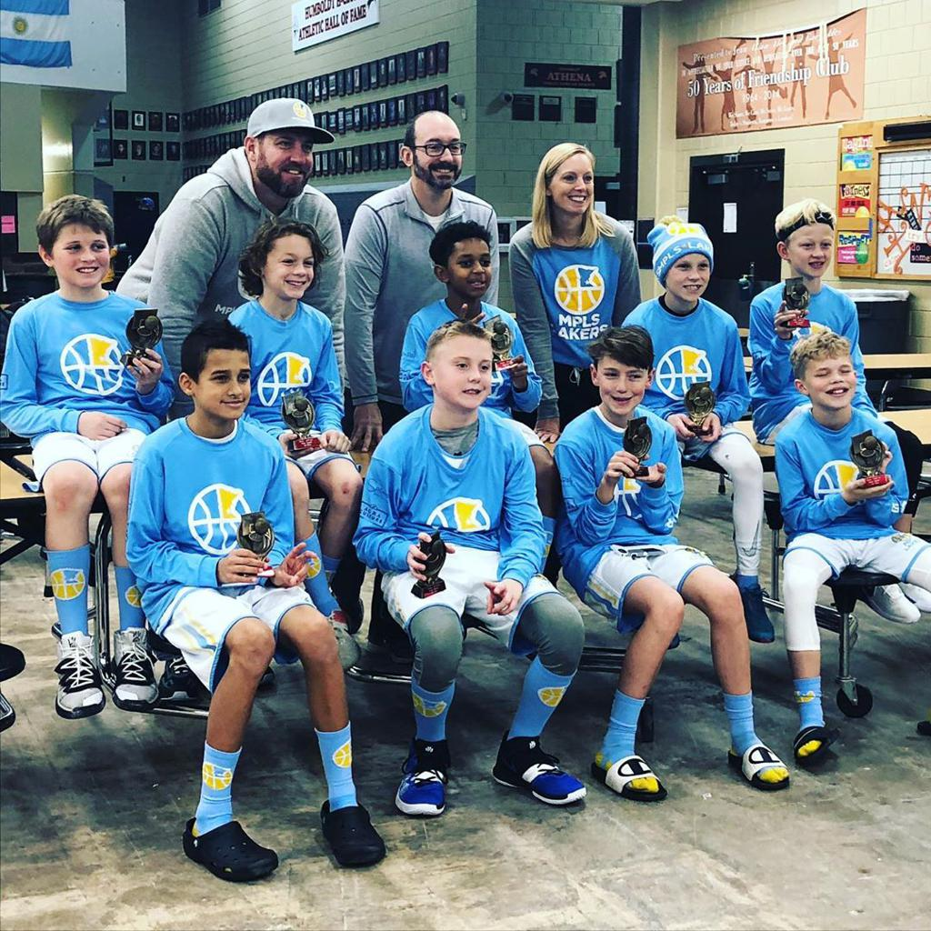 Minneapolis LakersBoys 5th Grade Gold pose with their trophies after earning 2nd place at the MYAS St Paul Winter SHootout tournament in St Paul, MN