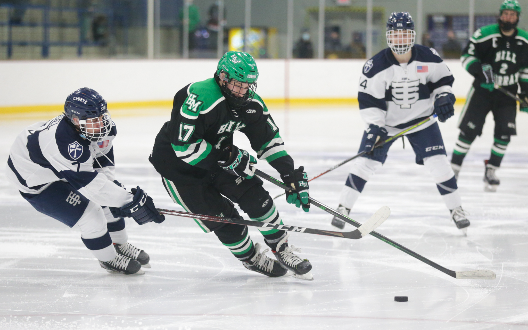 Hill-Murray's Dylan Godbout (17) circles in the offensive zone moments before scoring his second goal of the game against St. Thomas Academy Tuesday night. The Pioneers defeated the Cadets 7-3 in Mendota Heights. Photo by Jeff Lawler, SportsEngine