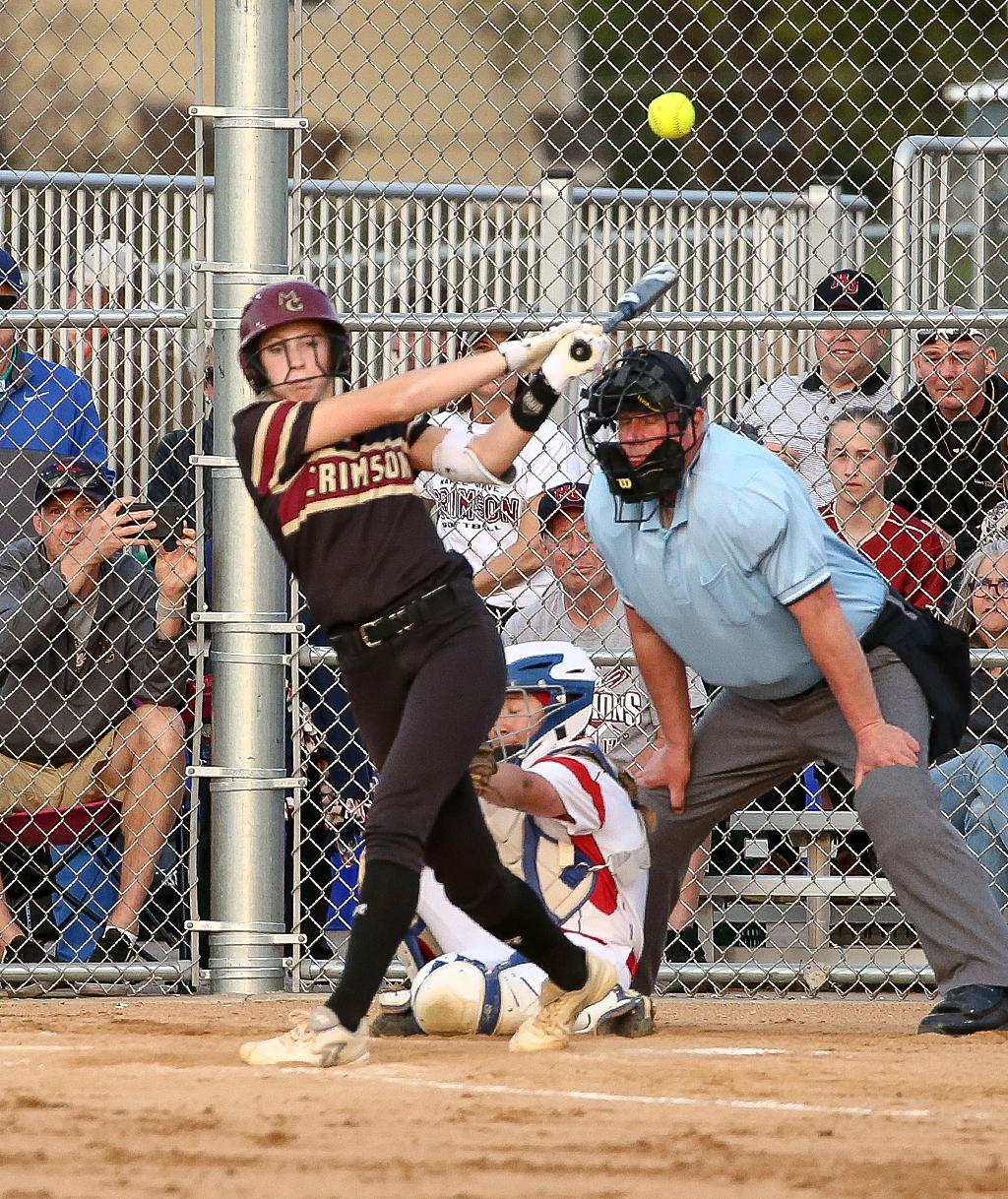 Ava Dueck sends the ball over the left field fence in the bottom of the first inning. Dueck added a two-run homer in the third to give Maple Grove a 3-0 win over Centennial on Tuesday night. Photo by Cheryl Myers, SportsEngine
