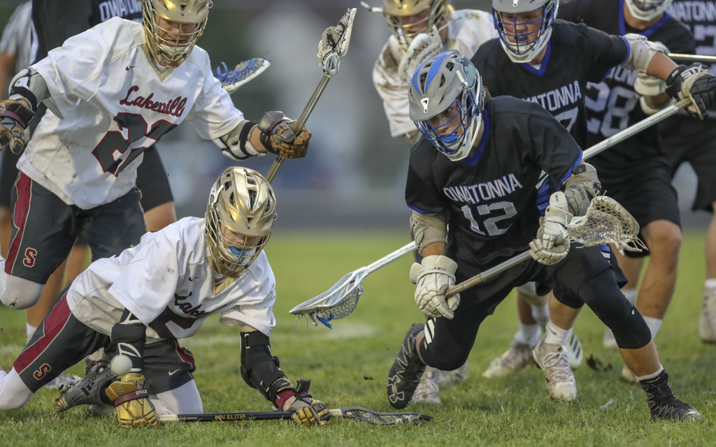 Owatonna's Mitchell Wiese goes after a loose ball against Lakeville South. The Huskies fell to the Cougars 11-6. Photo by Jeff Lawler, SportsEngine