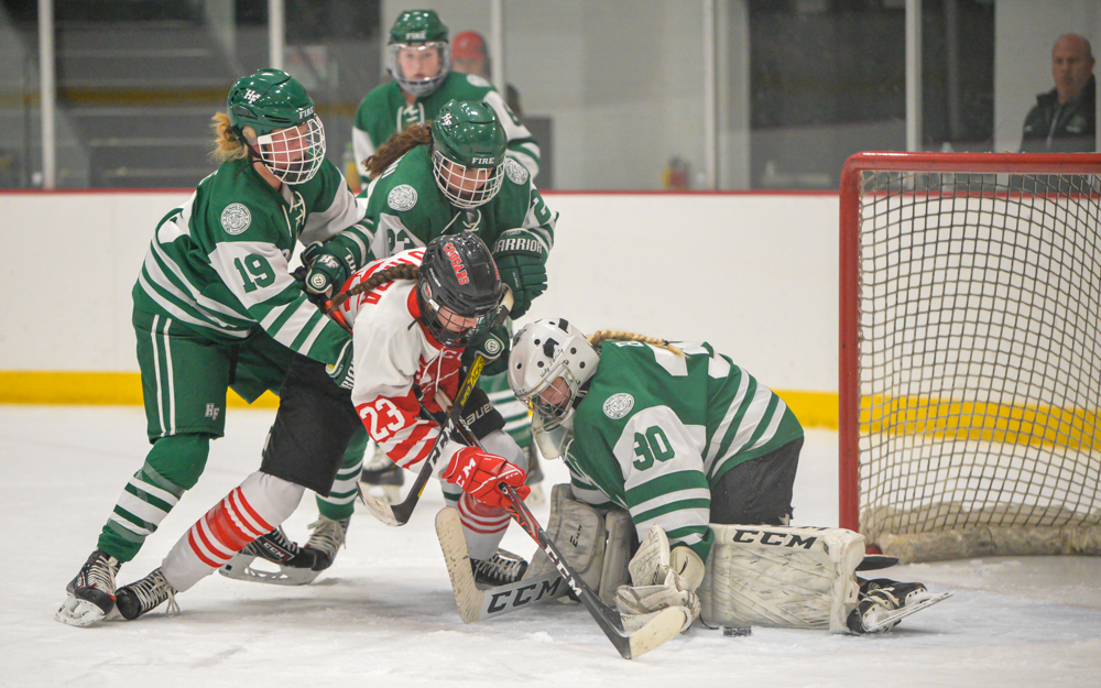 Holy Family Catholic goalie Sedona Blair gets a shutout Thursday night against Centennial with the Fire defeating the Cougars at Centennial 3-0. Photo by Earl J. Ebensteiner, SportsEngine