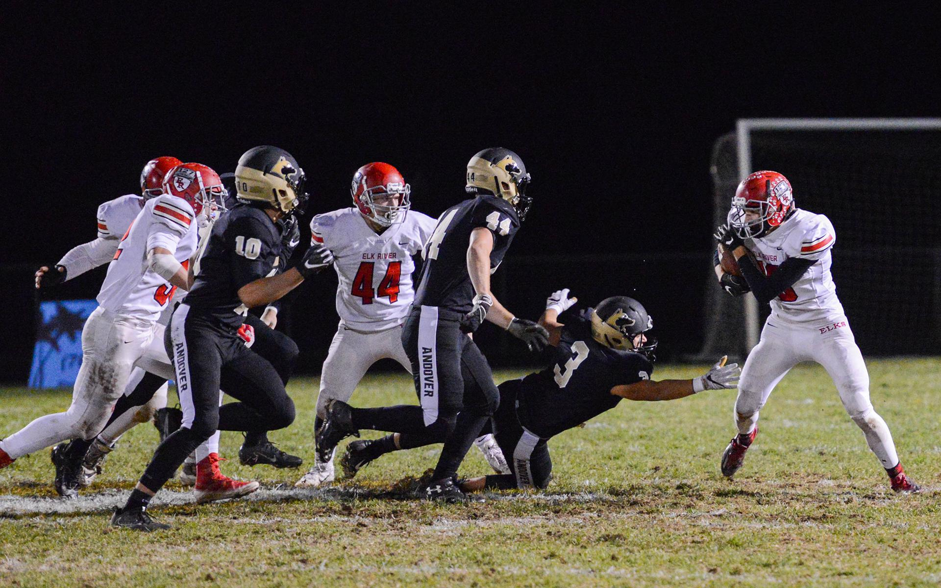 Elk River running back Logan Enkhaus dodges a tackle against Andover at Andover High School on Friday night. Photo by Carter Jones, SportsEngine