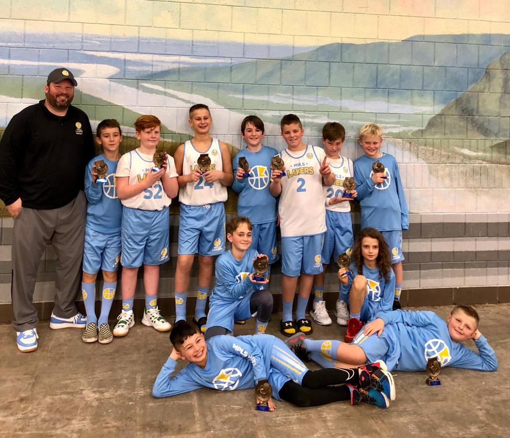 Minneapolis Lakers Boys 5th Grade Blue pose with their Trophies after becoming the Champions at the MYAS St Paul Winter Shootout tournament in St Paul, MN