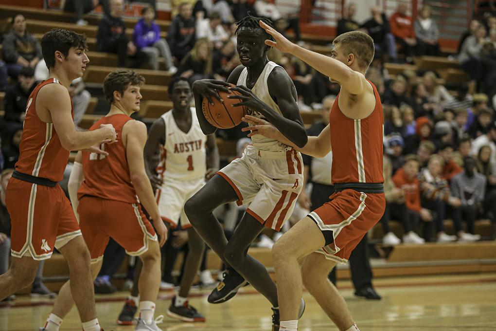 Austin's Ogur Gari drove past Lakeville North's Noah Frechette as the Packers rallied in the second half. Photo by Mark Hvidsten, SportsEngine