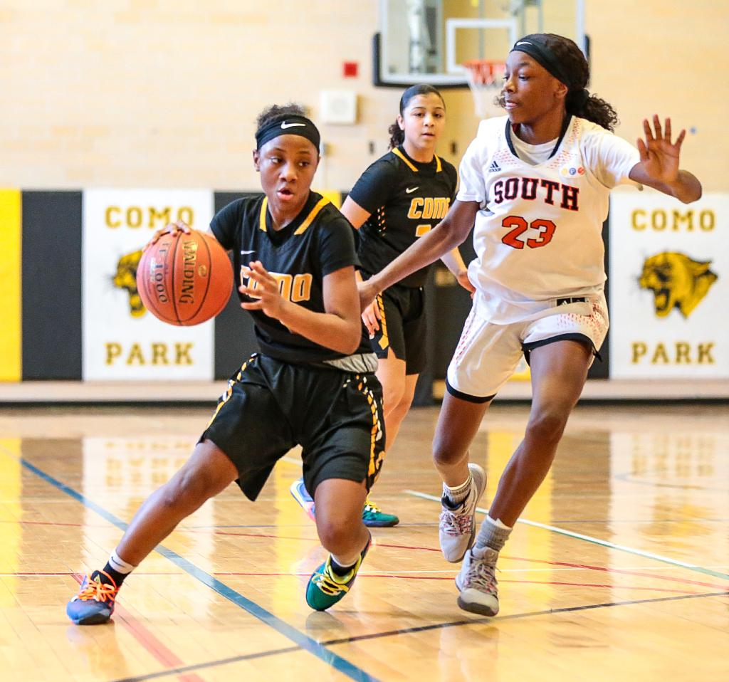 St. Paul Como Park's Ronnie Porter makes a move to the inside around Minneapolis South's Shanice Cox (23). Porter led the Cougars to their sixth straight City Championship on Saturday afternoon. Photo by Cheryl A. Myers, SportsEngine