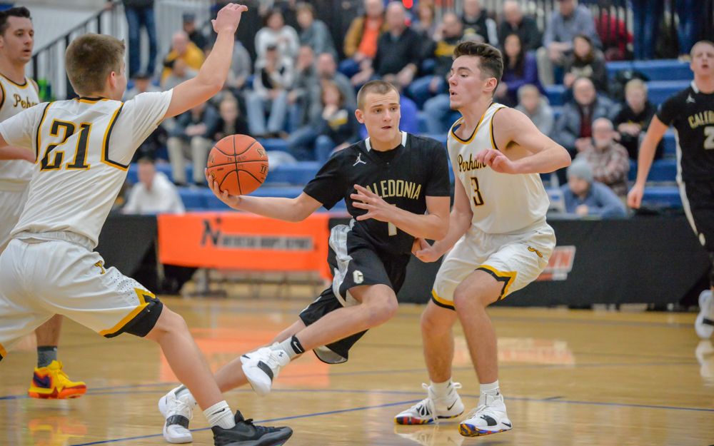 Caledonia's Eli King charges throughout the Yellowjackets' defense Saturday. Caledonia lost to Perham 66-61. Photo by Earl J. Ebensteiner, SportsEngine