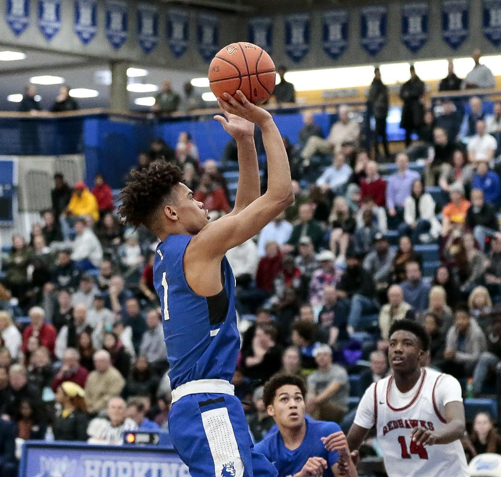 Hopkins' Jaelen Treml pulls up and shoots from the top of the key. Treml led the Royals' offense early in the game, scoring 16 of his 23 points in the first half. Photo by Cheryl A. Myers, SportsEngine