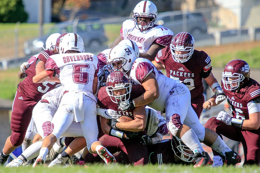 South St. Paul running back Quinn Christoffersen strained for an extra yard near the goal line as St. Paul Johnson defenders Angelo Gomez (5) and Eduardo Pacheco (54) push back. Photo by Mark Hvidsten, SportsEngine