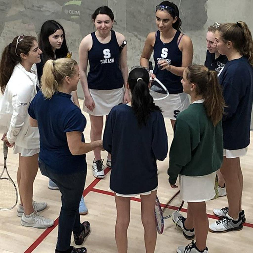 Alex huddles with the Varsity Team at Yale 2018