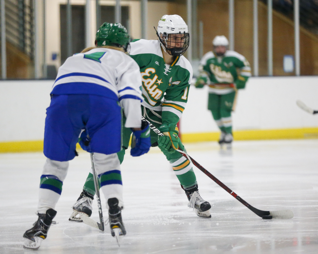 Edina's Emma Conner (16) carries the puck into the offensive zone against Blake Saturday afternoon. Conner had two goals and an assist in the Hornets' 4-1 victory over the Bears at the Blake Ice Arena. Photo by Jeff Lawler, SportsEngine