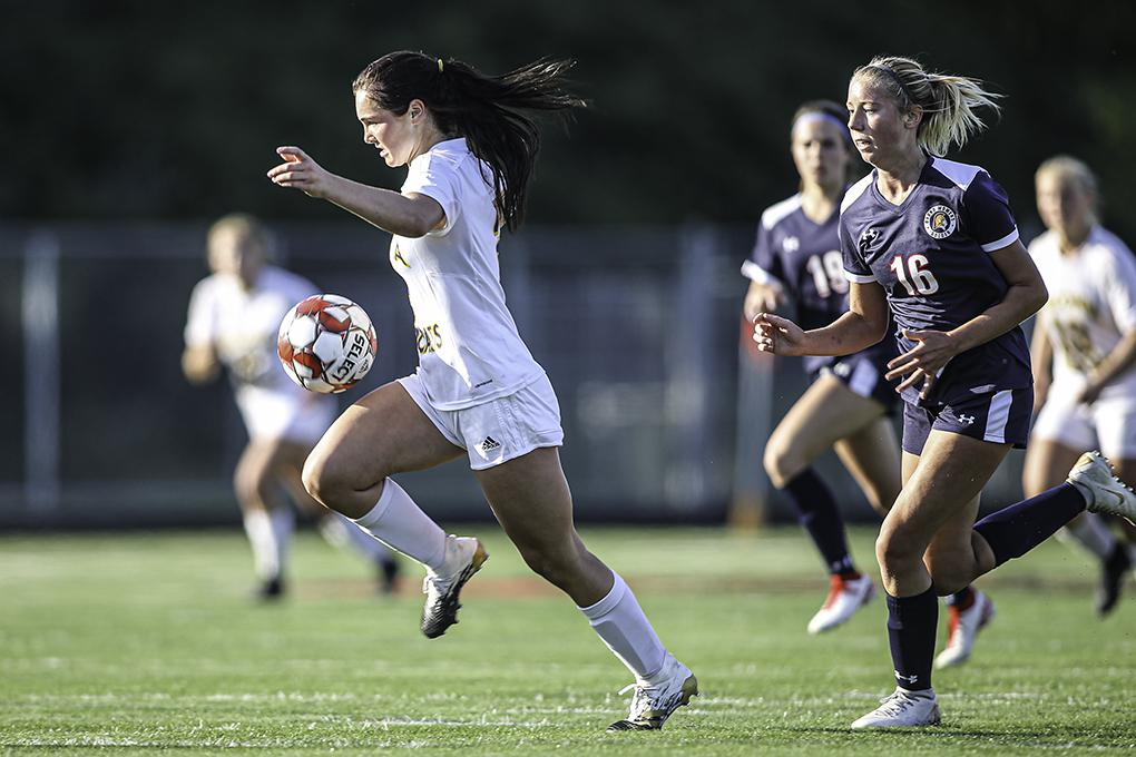 Waconia sophomore Brynley Theis carried the ball up the field in the second half. Theis's goal with less than six minutes to play led to a 1-1 tie with Orono. Photo by Mark Hvidsten, SportsEngine