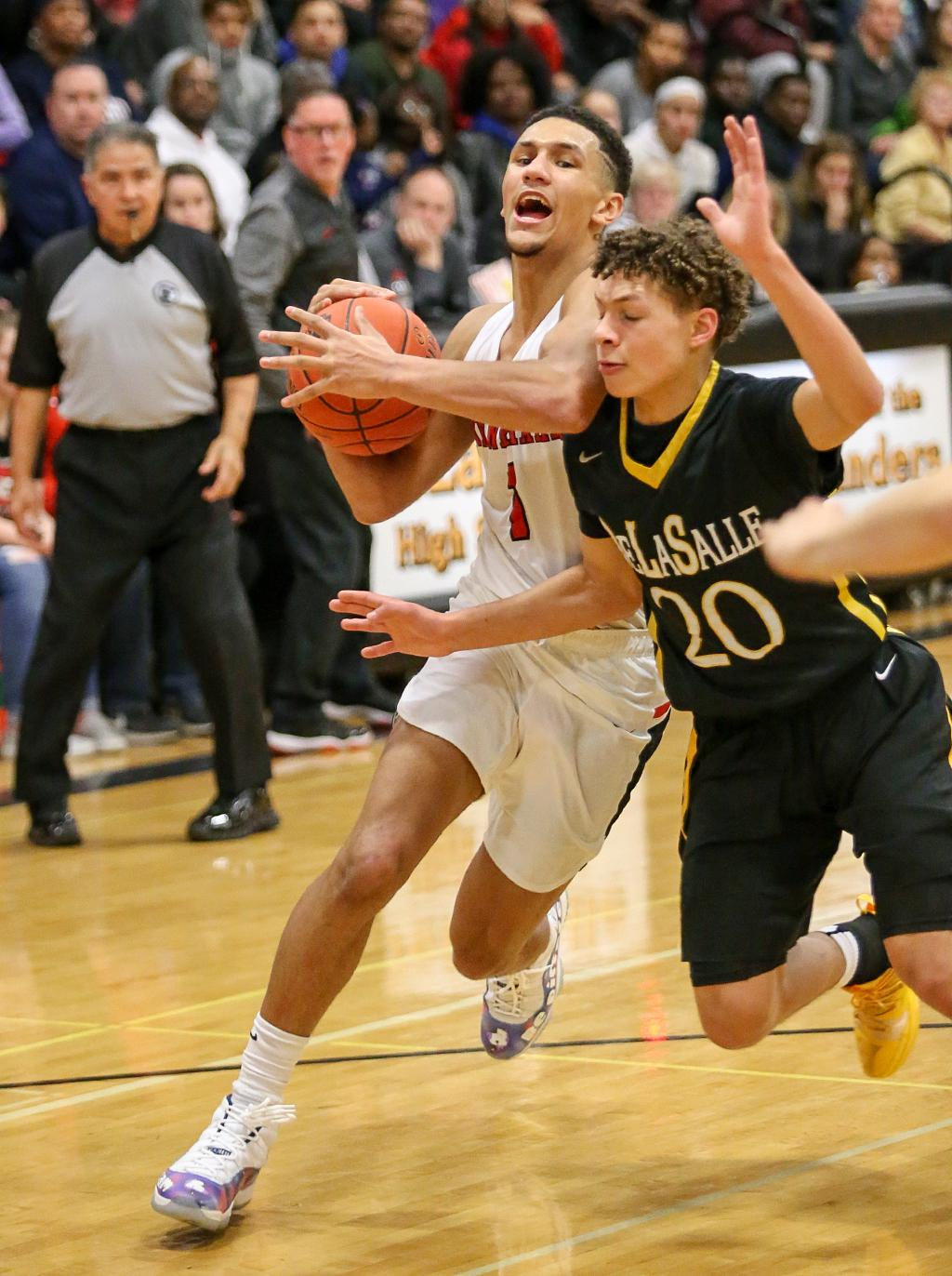 Jalen Suggs (1) spots an open lane and drives to the basket past defender Andrew Irvin (20). Suggs' 30 points propelled Minnehaha Academy to a 79-71 win over top-ranked DeLaSalle. Photo by Cheryl Myers, SportsEngine