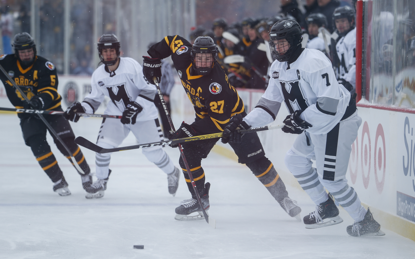 Minneapolis' Ben Murray (7) chips the puck into the corner against Warroad Saturday morning at Parade Stadium. Murray scored Minneapolis' goal in its 5-1 loss to the Warriors. Photo by Jeff Lawler, SportsEngine
