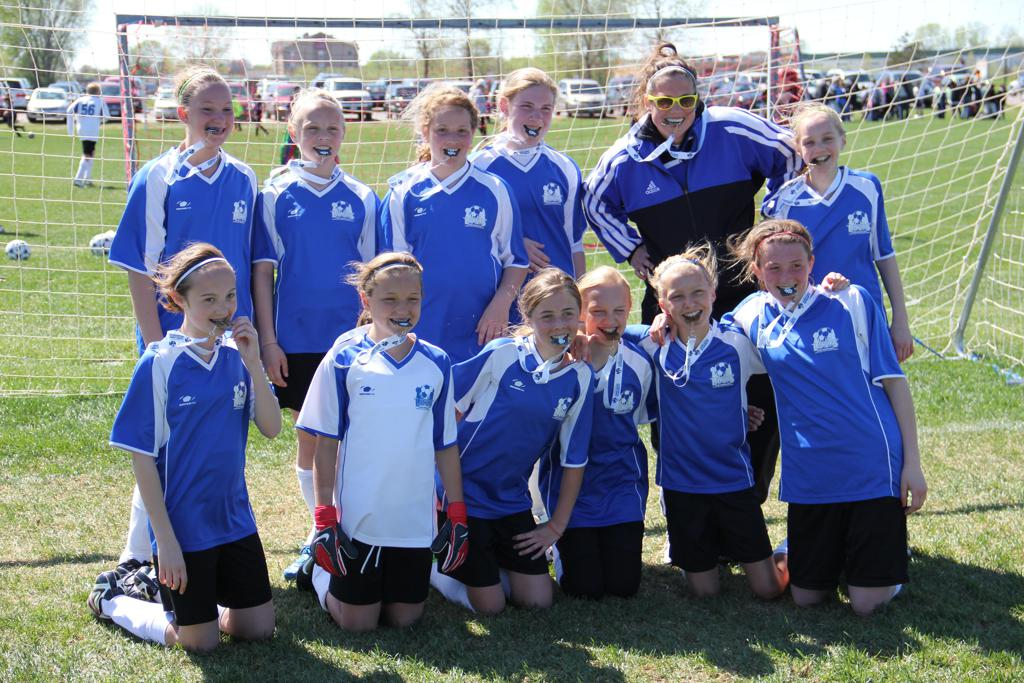 Our 2011 U12 LAYSA girls with Coach Jess - tournament champs, biting medals