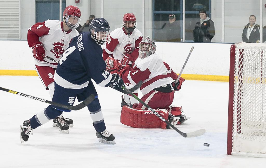 St. Thomas Academy's Will Soderling (14) scores off a rebound from teammate Tommy Deverell. Soderling's goal gave the Cadets a one-goal lead midway through the second period. Photo by Cheryl A. Myers, SportsEngine