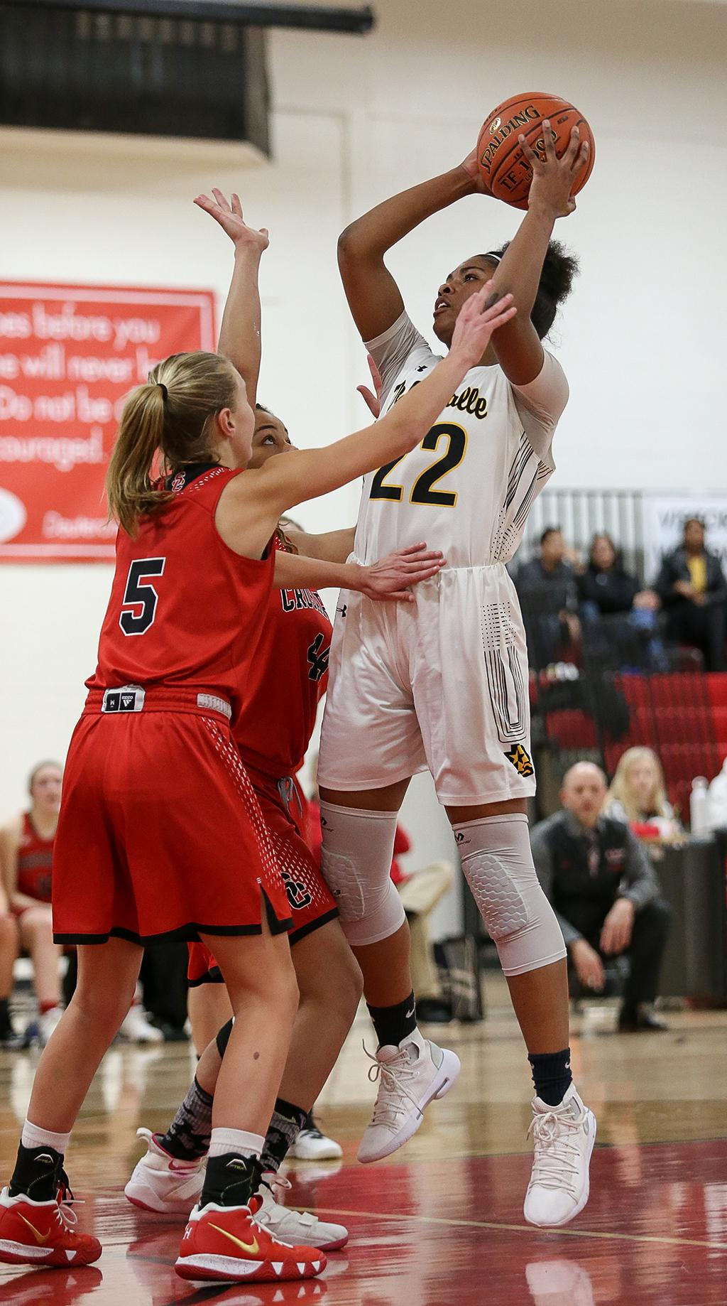 Nurjei Weems (22) pulls up at the top of the key for two points. Weems led all scoring with 20 points, helping DeLaSalle ease past St. Croix Lutheran 61-47 on Friday night. Photo by Cheryl Myers, SportsEngine