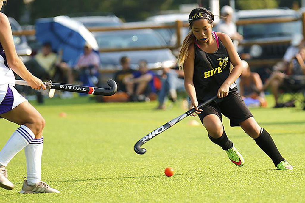 Hive Hockey Academy player dribbles with the ball