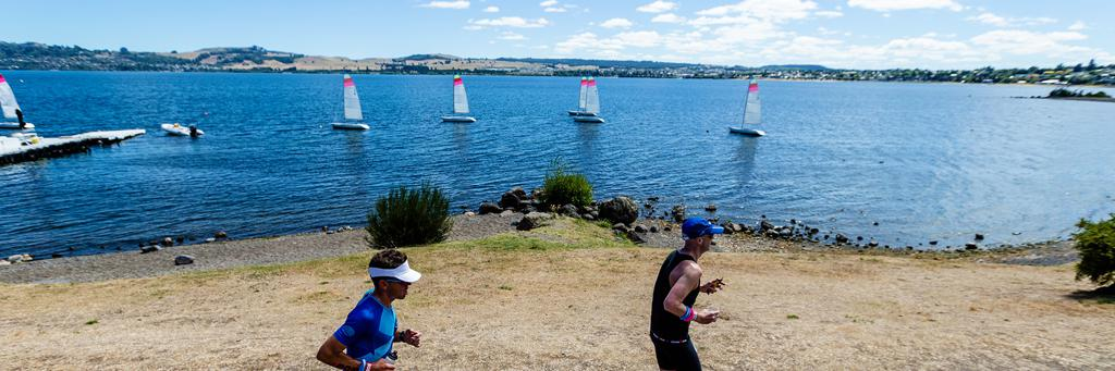 Runners along the Lake Taupo foreshore