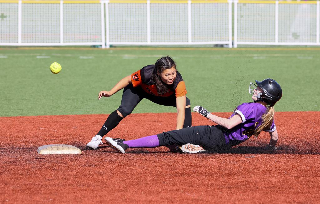 Cretin-Derham Hall's Ryan Courtney slides into second base safely, setting up the first of two runs in the fifth inning. The Raiders fell 5-2 to the Bears on Friday night. Photo by Cheryl A. Myers, SportsEngine