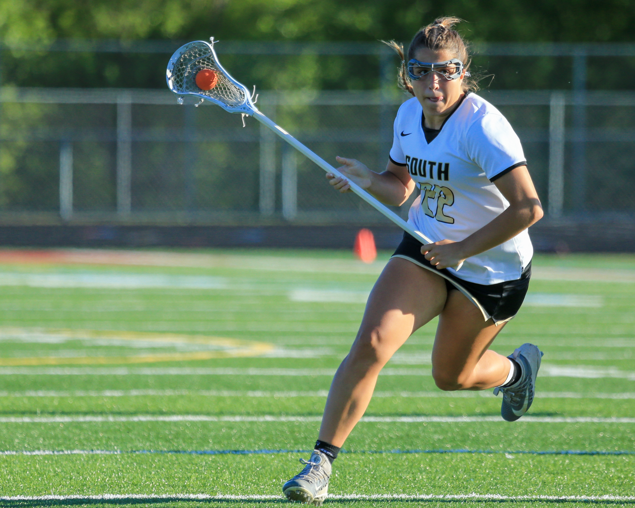 Lakeville South's Brielle Fannin (22) had two goals and three assists in the team's 15-13 victory over Blake Friday evening. Fannin leads the state in assists with 54 for the season. Photo by Jeff Lawler, SportsEngine
