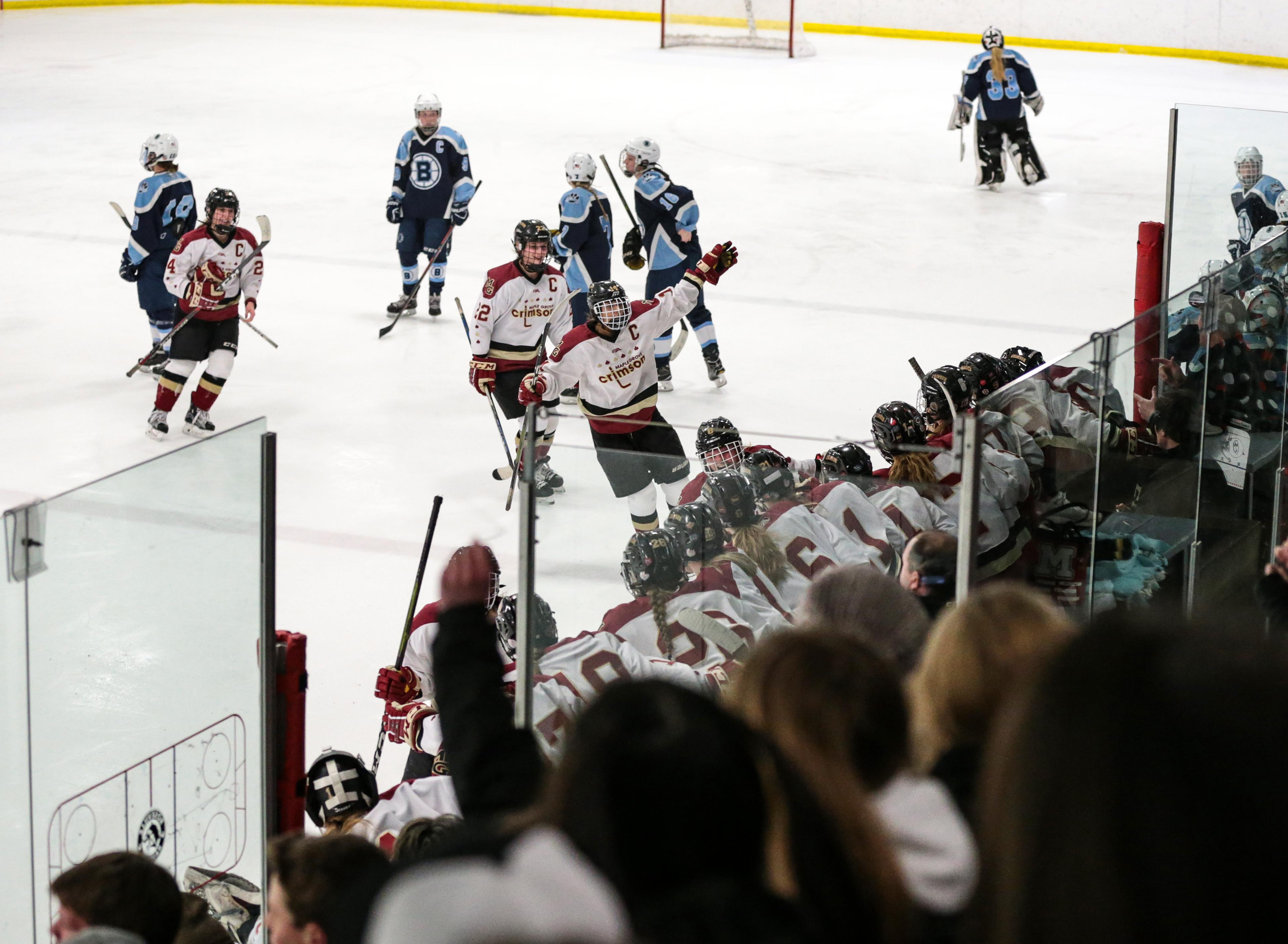 The Maple Grove bench celebrates Lauren Stenslie's empty-net goal with 31 seconds remaining in the game. Photo by Cheryl A. Myers, SportsEngine