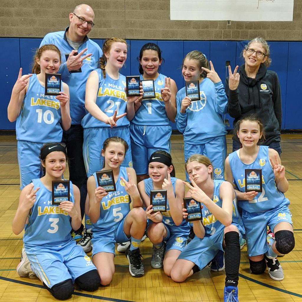 Mpls Lakers Youth Traveling Basketball Program Inc Girls 6th Grade Gold pose with their Trophies after placing 2nd at the Park Center Winter Shootout tournament in Brooklyn Park, MN