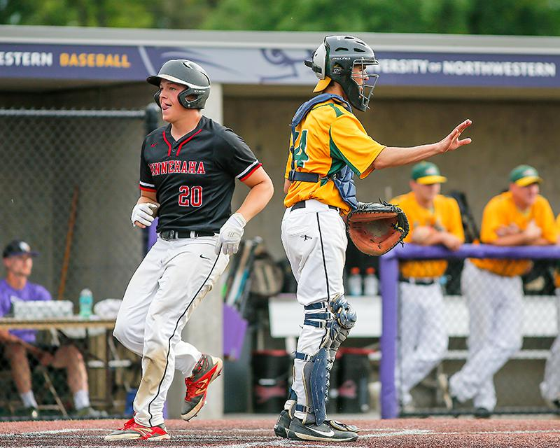 Bennett Theisen (20) passes New Life Academy catcher Riley Grohn with a third-inning run. Theisen doubled, singled, walked twice and pitched a complete game for Minnehaha Academy. Photo by Mark Hvidsten, SportsEngine