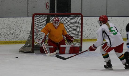 Goaltender Ashley Cochran stops sister Kelsey on Sunday at KCIC