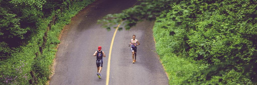 Two triathletes running on IRONMAN 70.3 Connecticut course