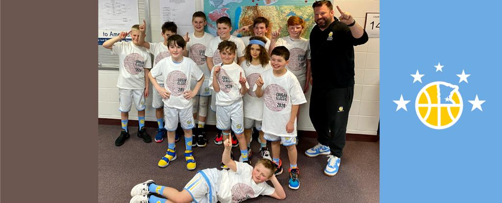 Mpls Lakers Youth Traveling Basketball Program Inc Boys 5th Grade Blue pose with their T-Shirts after becoming the Champions at the Lakeville South Cougar Classic tournament in Lakeville, MN