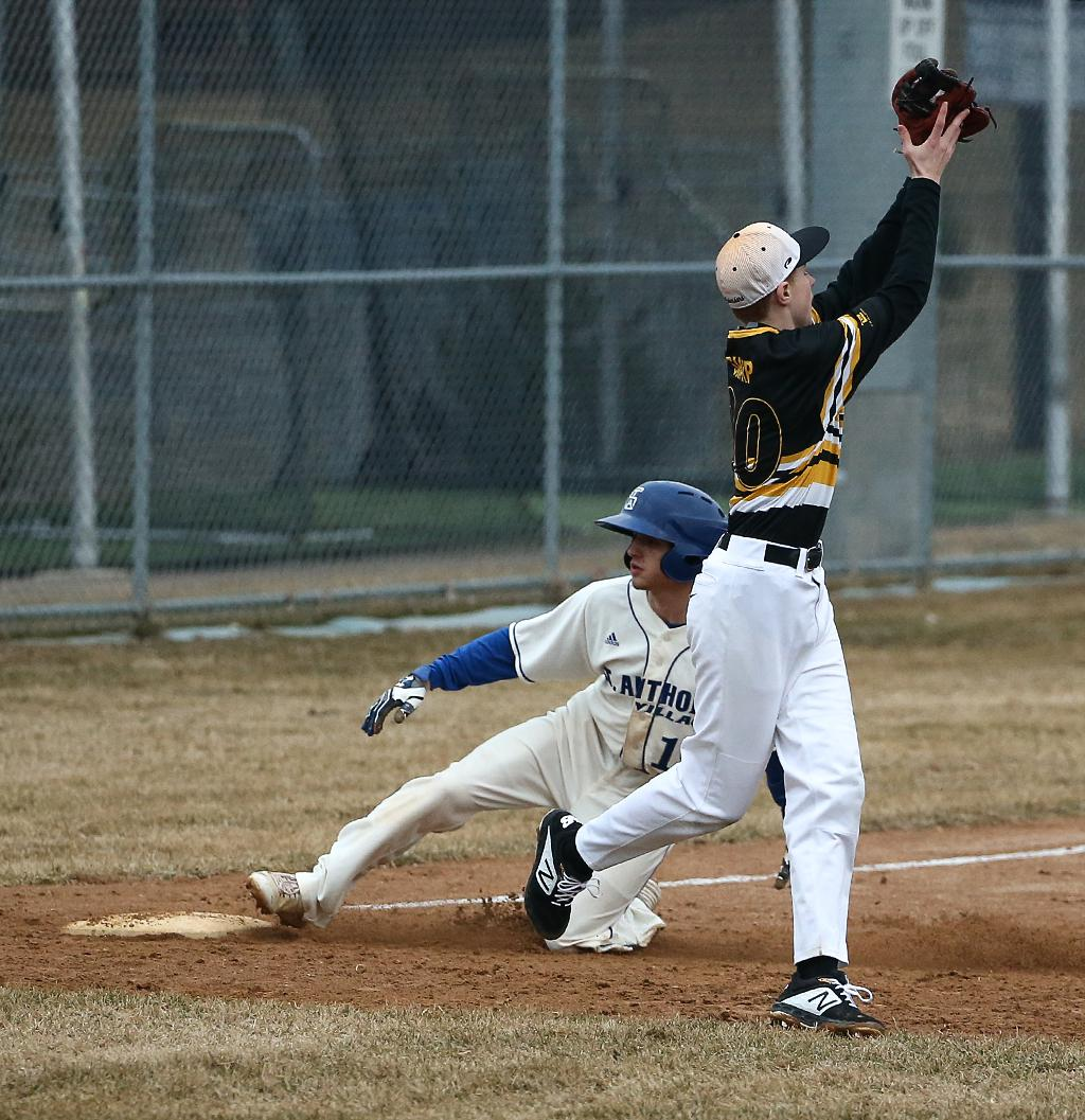 Troy Ellison slides into third base in the bottom of the seventh inning giving the Huskies their best scoring chance in the game. St. Anthony Village lost to DeLaSalle 4-0 on Friday night. Photo by Cheryl Myers, SportsEngine