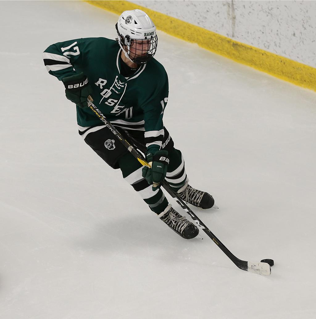 Junior forward Kate Helgeson clears the puck from behind the net. Roseau fell 8-0 on Friday night as it opened the 2019-20 season on the road at Minnetonka. Photo by Cheryl A. Myers, SportsEngine