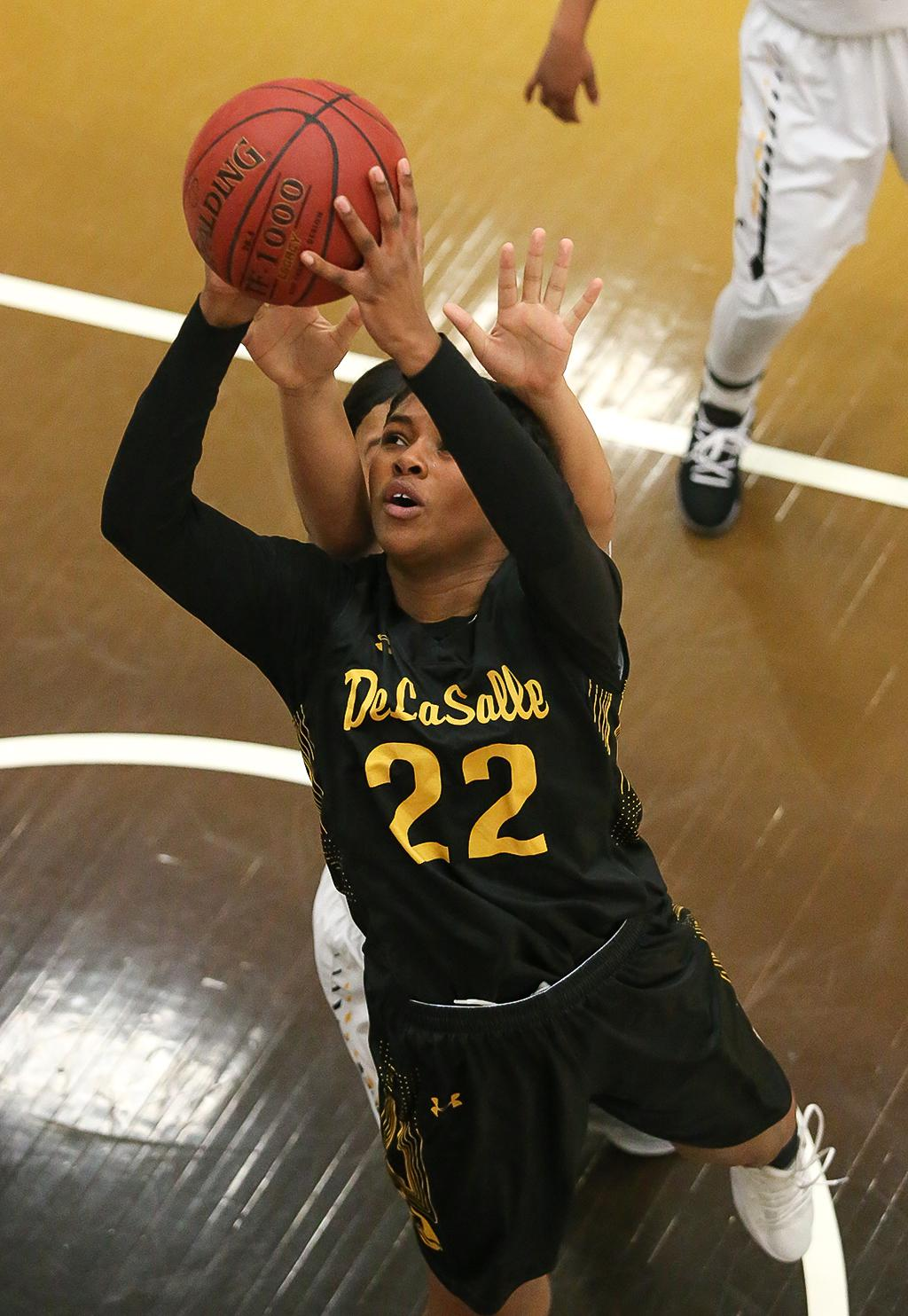 DeLaSalle junior Nurjei Weems (22) drives the lane for two of her game-high 18 points. The Islanders built an early first half lead and held on to beat the Cougars 68-54 advancing to the section final game on Thursday. Photo by Cheryl Myers, SportsEngine