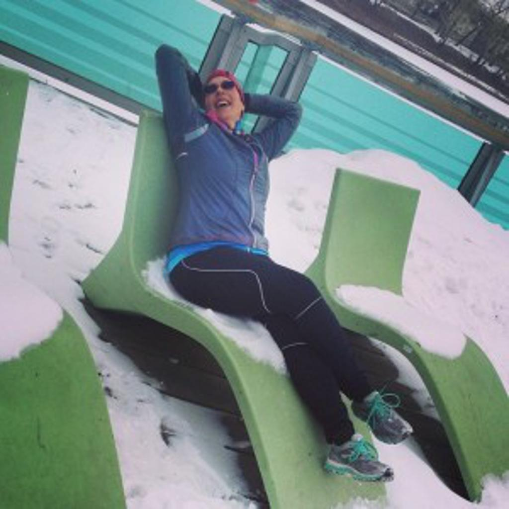 runner laying on a lawnchair in winter