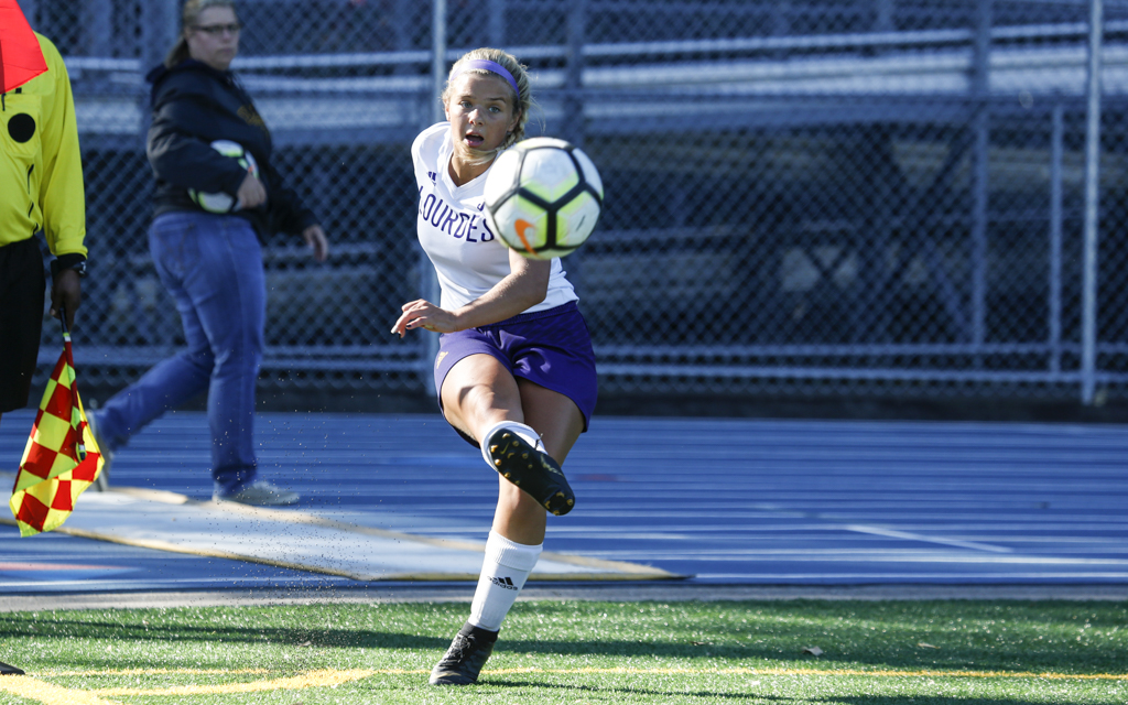 Rochester Lourdes senior Emma Schmitz drives the ball toward the Breck net on a corner kick. The Eagles fell to the Mustangs 1-0 in Golden Valley. Photo by Jeff Lawler, SportsEngine
